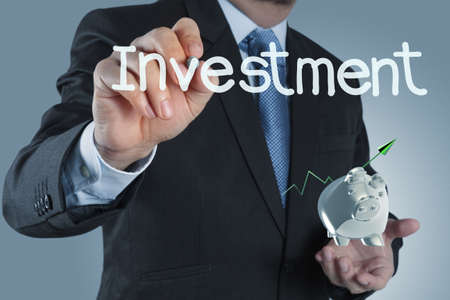 businessman hand pointing to investment concept Stock Photo - 16707218