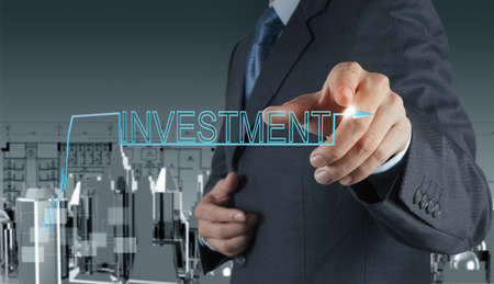 businessman hand pointing to investment concept photo