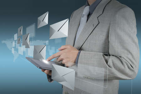 penfriend: businessman hand use tablet computer with email icon