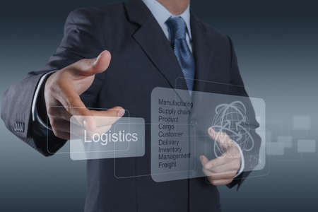 virtual office: businessman hand shows logistics diagram as concept