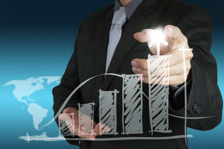businessman hand points to business strategy as concept Stock Photo - 16706369