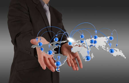 hand holding globe: businessman hand holds social network as concept Stock Photo