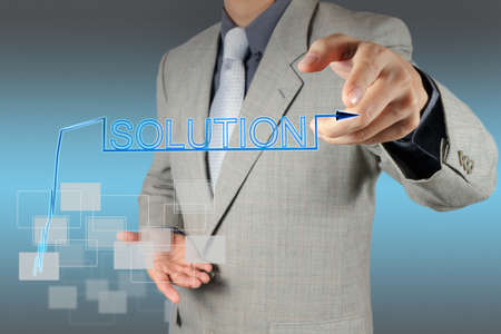 businessman hand pushing solution graph on a touch screen interface Stock Photo - 16707245