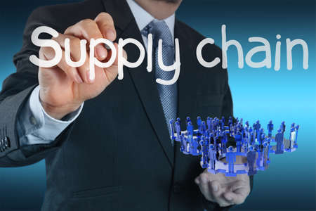 business man writing supply chain management concept by flow from supplier to customer Stock Photo