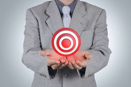 business rival: businessman hand pointing target symbol as success concept