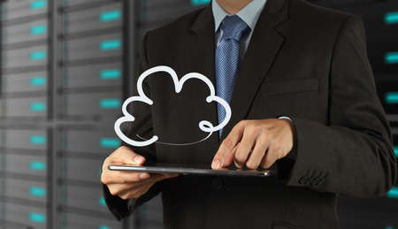 Businessman drawing a Cloud Computing diagram on the new computer interface Stock Photo - 16707264