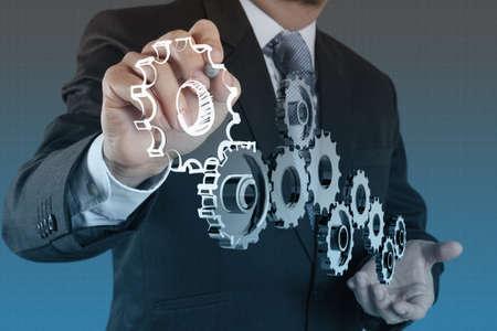 ingenieria industrial: mano empresario espect�culo de engranajes para el �xito como concepto