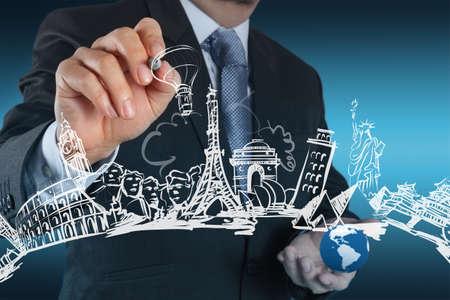 pise: businessman hand draws dream travel around the world