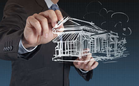 businessman draws building development concept Stock Photo - 16695314