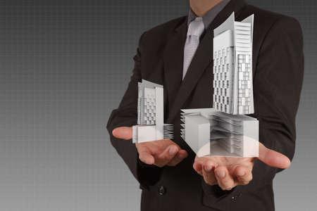 businessman draws building development concept Stock Photo - 16695300