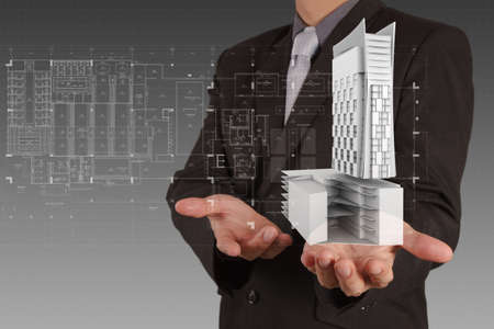 businessman draws building development concept Stock Photo - 16695308