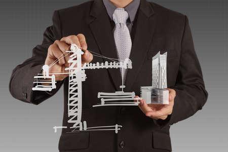 businessman draws building development concept Stock Photo - 16695297