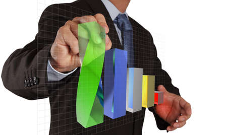 businessman hand drawing a pie chart and 3d graph Stock Photo - 16703641