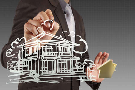 businessman draws building development concept photo