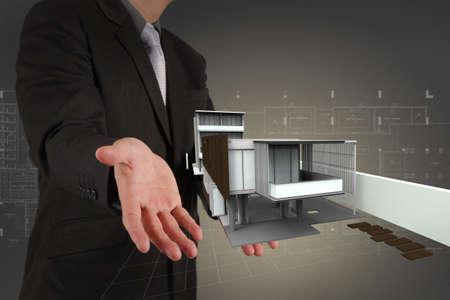 the top model: businessman draws building development concept