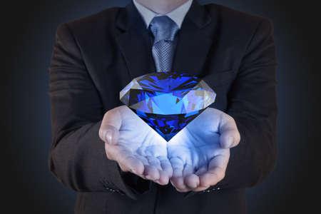 businessman hand show diamond as business chart concept Stock Photo - 16706671