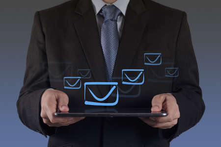 businessman hand use tablet computer with email icon Stock Photo - 16707141