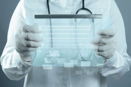 Medicine doctor working with modern computer interface Stock Photo - 16704544