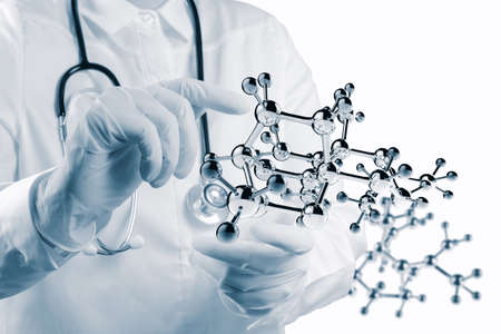 med: Stethoscope in hand with capsule pill and molecule as medical concept