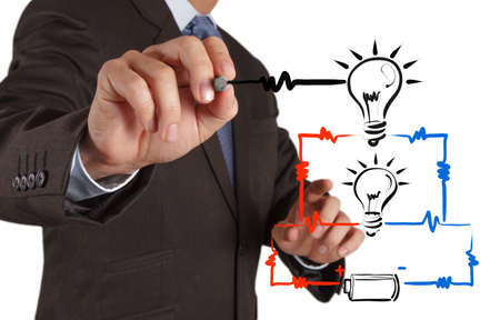 electric current: businessman hand draws electrical diagram series and parallel connection concept