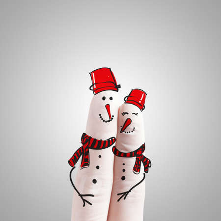A lovely couple hand drawn and finger as snowmen as concept photo