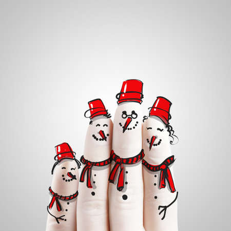 A lovely family hand drawn and finger of snowmen,as concept idea photo