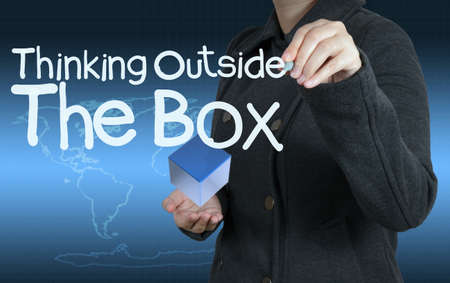 problemsolving: businesswoman hand draws word thinking outside the box as concept Stock Photo