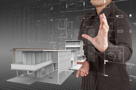 female architect: businesswoman hand shows house model as concept