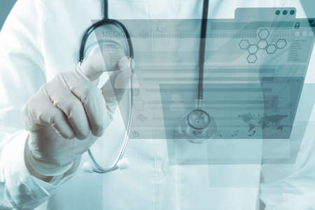 Medicine doctor working with modern computer interface Stock Photo - 16883606