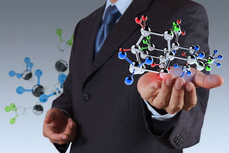 businessman holding a molecule as science concept photo