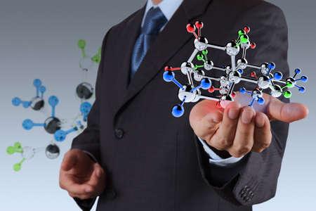 biotech: businessman holding a molecule as science concept
