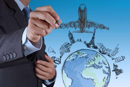 airplane travel: businessman hand draws airplane travel around the world Stock Photo