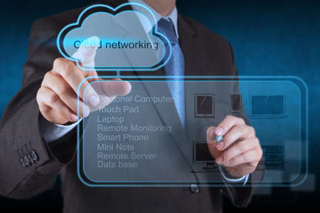 computer service: Businessman hand touch a Cloud Computing diagram on the new computer interface