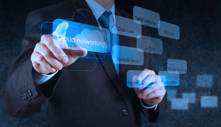 mobile application: Businessman hand pointing on a Cloud Computing diagram on the new computer interface