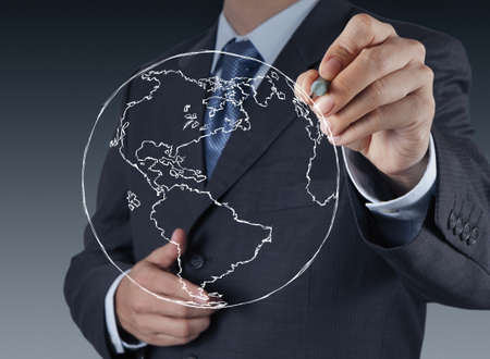 businessman hand drawing abstract globe on virtual screen Stock Photo - 17156983