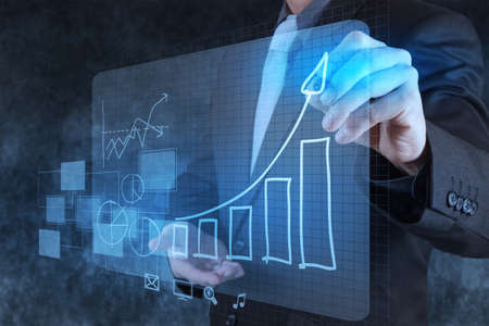 businessman hand drawing virtual chart business on texture background Stock Photo - 17156931