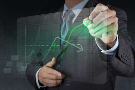 businessman hand drawing virtual chart business as concept Stock Photo - 17157037