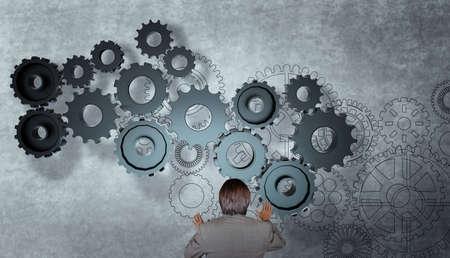 impulse: Gesch�ftsmann arbeitet mit Getriebe zum Erfolg als Konzept