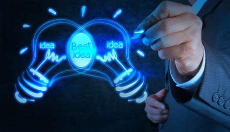 conputer: businessman hand with a pen drawing light bulb on touch screen conputer