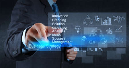 performances: businessman hand points to business strategy diagram as concept Stock Photo