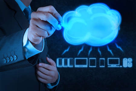 Businessman drawing a Cloud Computing diagram on the new computer interface Stock Photo - 17542966