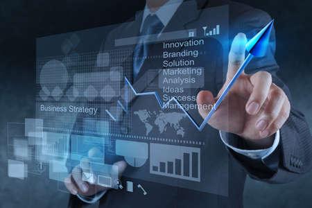 achievement charts: businessman hand touch 3d virtual chart business Stock Photo