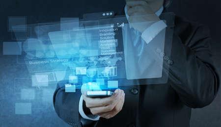 wireless tool: businessman shows modern technology as concept