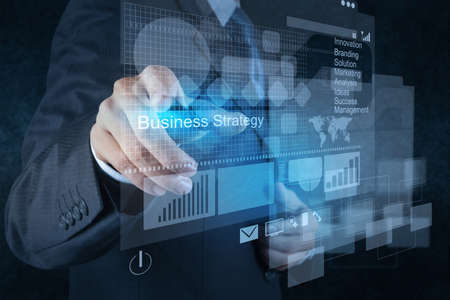 business project: businessman hand points to business strategy as concept Stock Photo