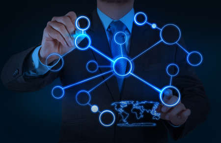 computer networking: businessman working with new modern computer show social network structure as concept Stock Photo
