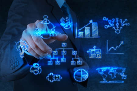 businessman hand points to business strategy as concept Stock Photo - 17542970