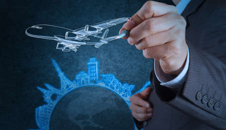 airplane travel: businessman hand draws airplane travel around the world as concept