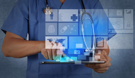 man doctor: Medicine doctor working with modern tablet computer and virtual interface