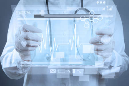 Medicine doctor working with modern computer interface Stock Photo - 17543041