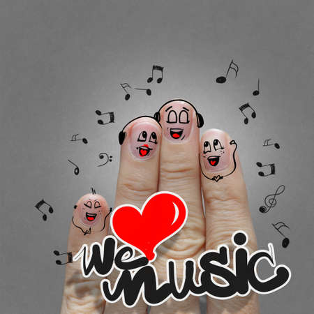 love music: the happy finger family holding we love music and sing a song